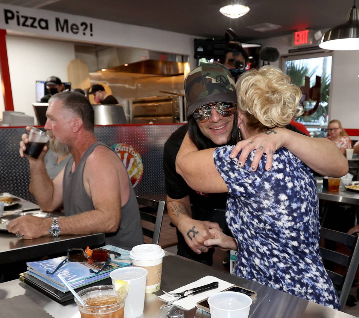 Criss Angel greets Kathy Lee at his new restaurant, CABLP, in Overton during the grand opening ...
