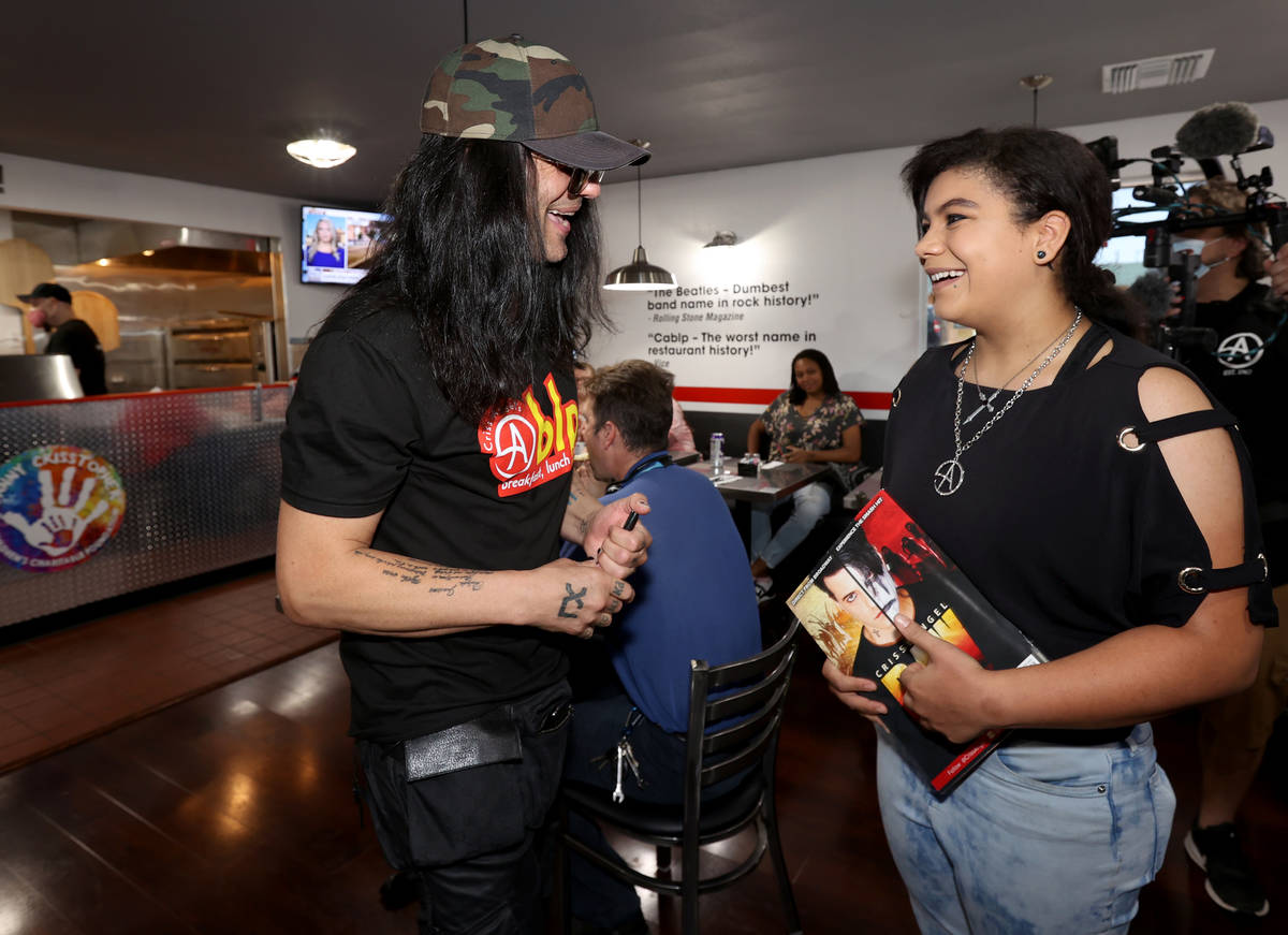 """Criss Angel greets Patricia """"Z"""" Lucas at his new restaurant, CABLP, in Overton during the grand ..."""