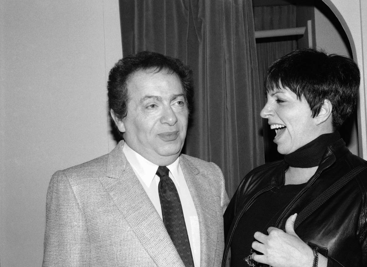 FILE - In this Feb. 4, 1991, file photo, Liza Minnelli chats with comic Jackie Mason during a v ...