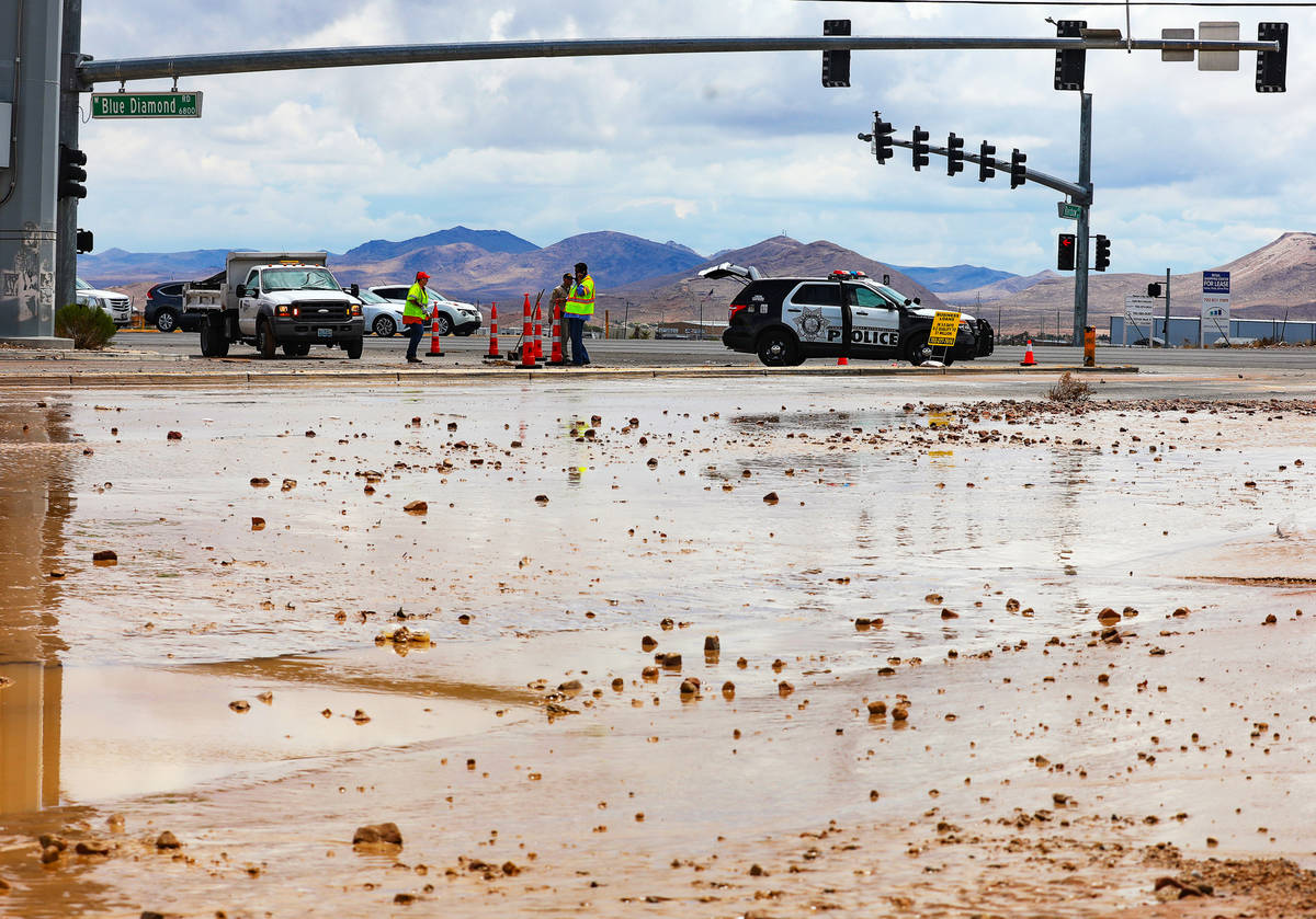 Officers block off part of Rainbow Boulevard by Blue Diamond after it was washed out from a rec ...