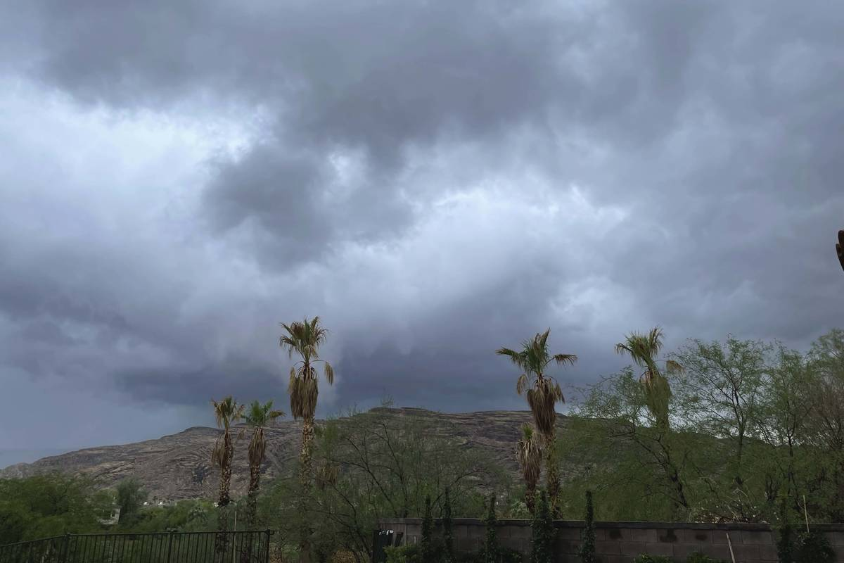 Storm clouds hang over Red Rock Canyon in western Las Vegas on Monday, July 26, 2021. (Belinda ...