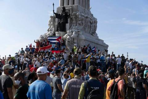 Anti-government protesters gather at the Maximo Gomez monument in Havana, Cuba, Sunday, July 11 ...