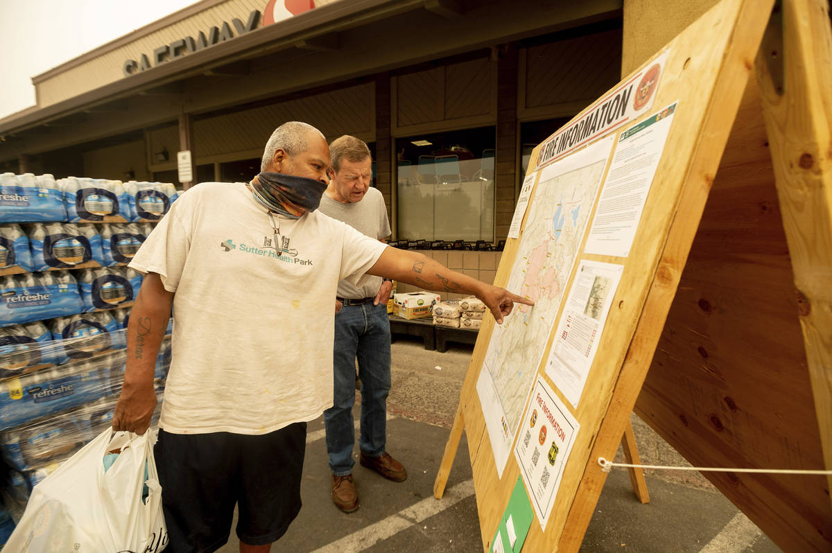 As new evacuation orders take effect for the Dixie Fire, Carlos Duran, left, and Rich McFeely e ...