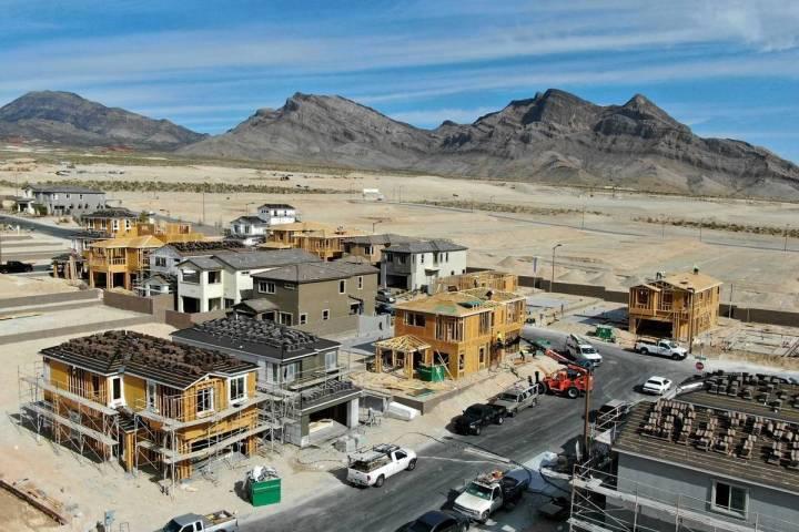 An aerial view of homes under construction in Cascades, a housing development near Far Hills Av ...