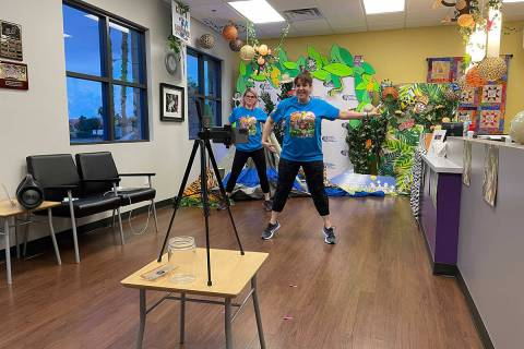 Volunteers dance during a livestream for Camp Cartwheel, an annual summer camp for children wit ...