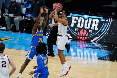 Gonzaga guard Jalen Suggs (1) shoots over UCLA guard David Singleton (34) to win the game durin ...