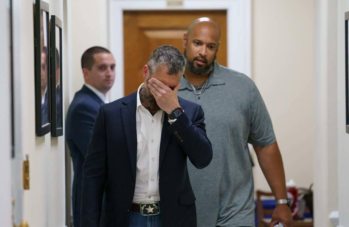 In this June 25, 2021 file photo, Michael Fanone, front, a Washington Metropolitan Police Depar ...
