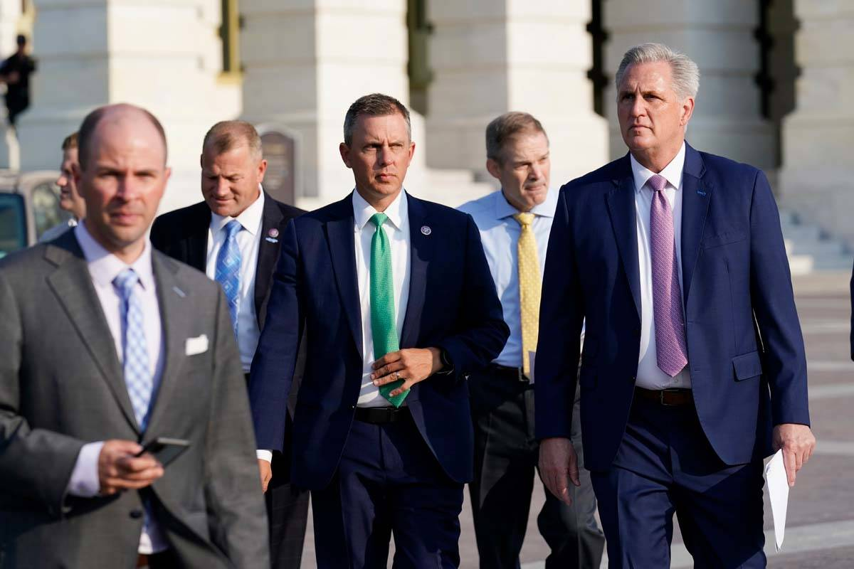 House Minority Leader Kevin McCarthy, R-Calif., right, and other Republican House members, walk ...