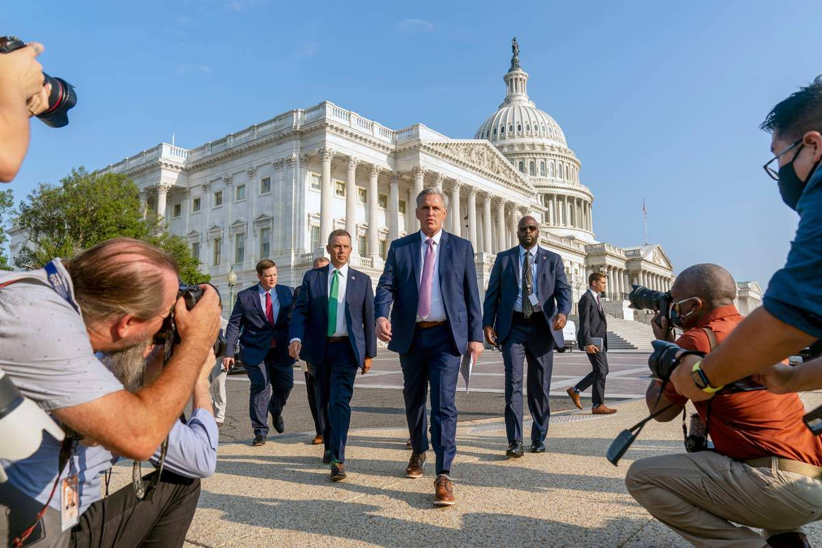 House Minority Leader Kevin McCarthy of Calif., accompanied by Rep. Kelly Armstrong, R-N.D., se ...