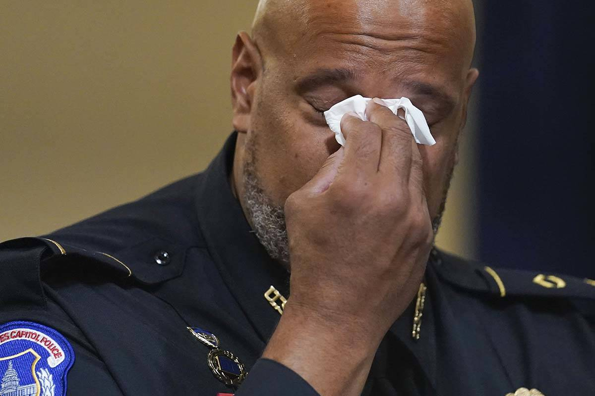 Washington Metropolitan Police Department officer Daniel Hodges wipes his eyes during the House ...