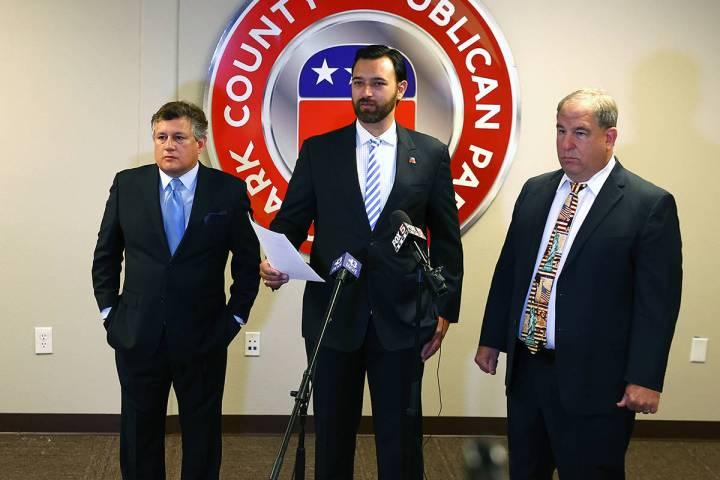 Clark County Republican Party Vice Chairman Stephen Silberkraus, center, speaks during a press ...