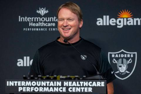 Raiders head coach Jon Gruden smiles while speaking to the media during the start of training c ...
