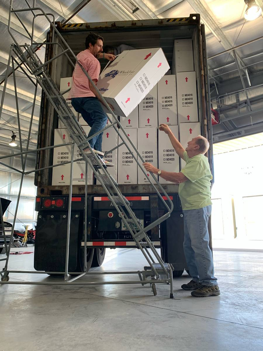 Volunteers unload wheelchairs that will be donated to Nevadans in need. The Wheelchair Foundati ...