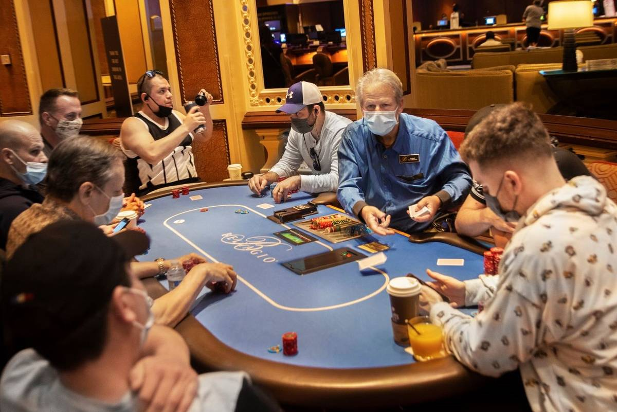 The poker tables at Bellagio are packed on Friday, May 14, 2021, in Las Vegas. (Benjamin Hager/ ...