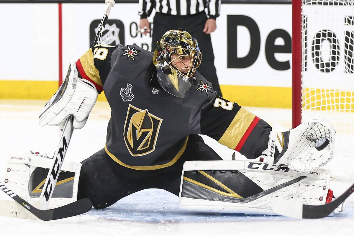 Golden Knights goaltender Marc-Andre Fleury (29) blocks a shot from Washington Capitals center ...
