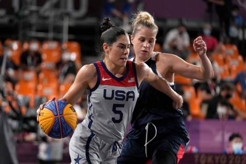 United States' Kelsey Plum (5) drives past Olga Frolkina (15), of the Russian Olympic Committee ...
