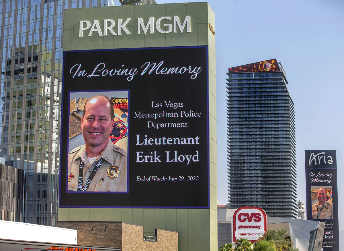 The marquee at Park MGM honors Las Vegas police Lt. Erik Lloyd as his funeral procession moves ...