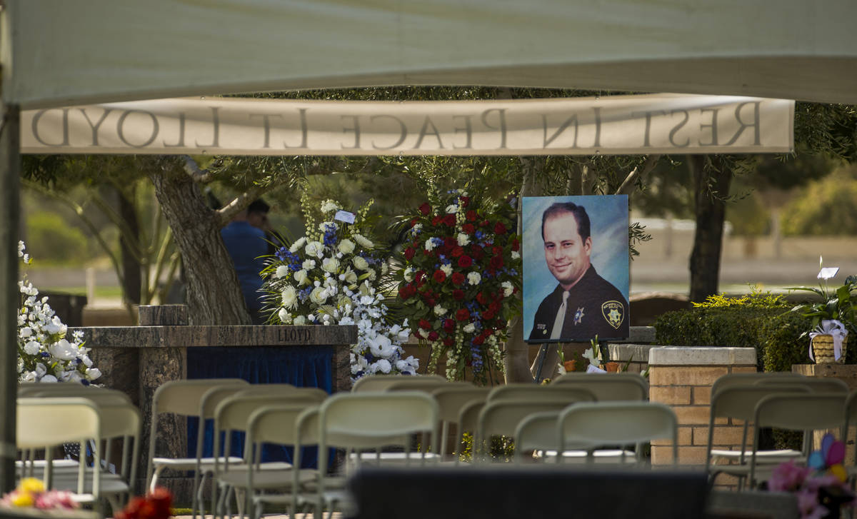 A portrait awaits mourners before a burial service for Las Vegas police Lt. Erik Lloyd on Aug. ...