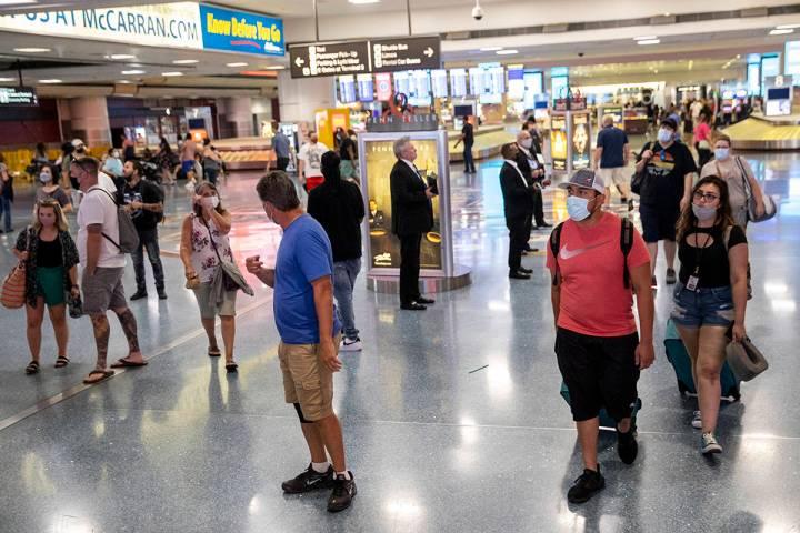 People arrive at McCarran International Airport Terminal 1 in Las Vegas, Friday, July 2, 2021. ...