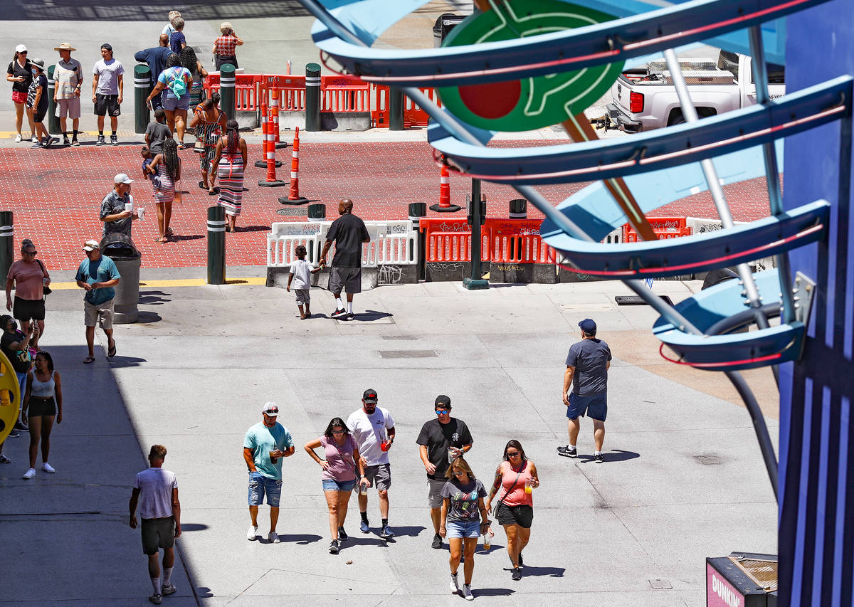 Visitors walk on the Fremont Street Experience in Downtown Las Vegas Wednesday, July 28, 2021. ...