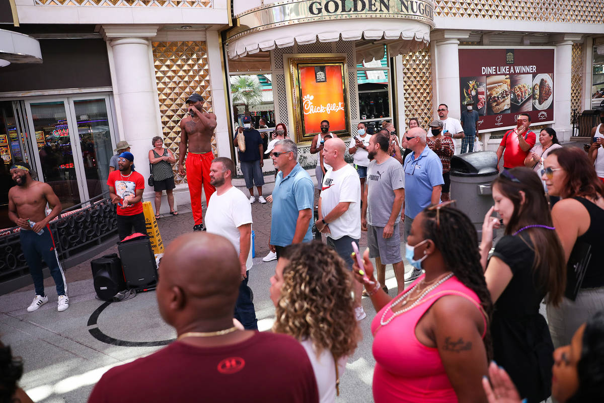 Buskers entertain visitors under the Fremont Street Experience in Downtown Las Vegas Wednesday, ...