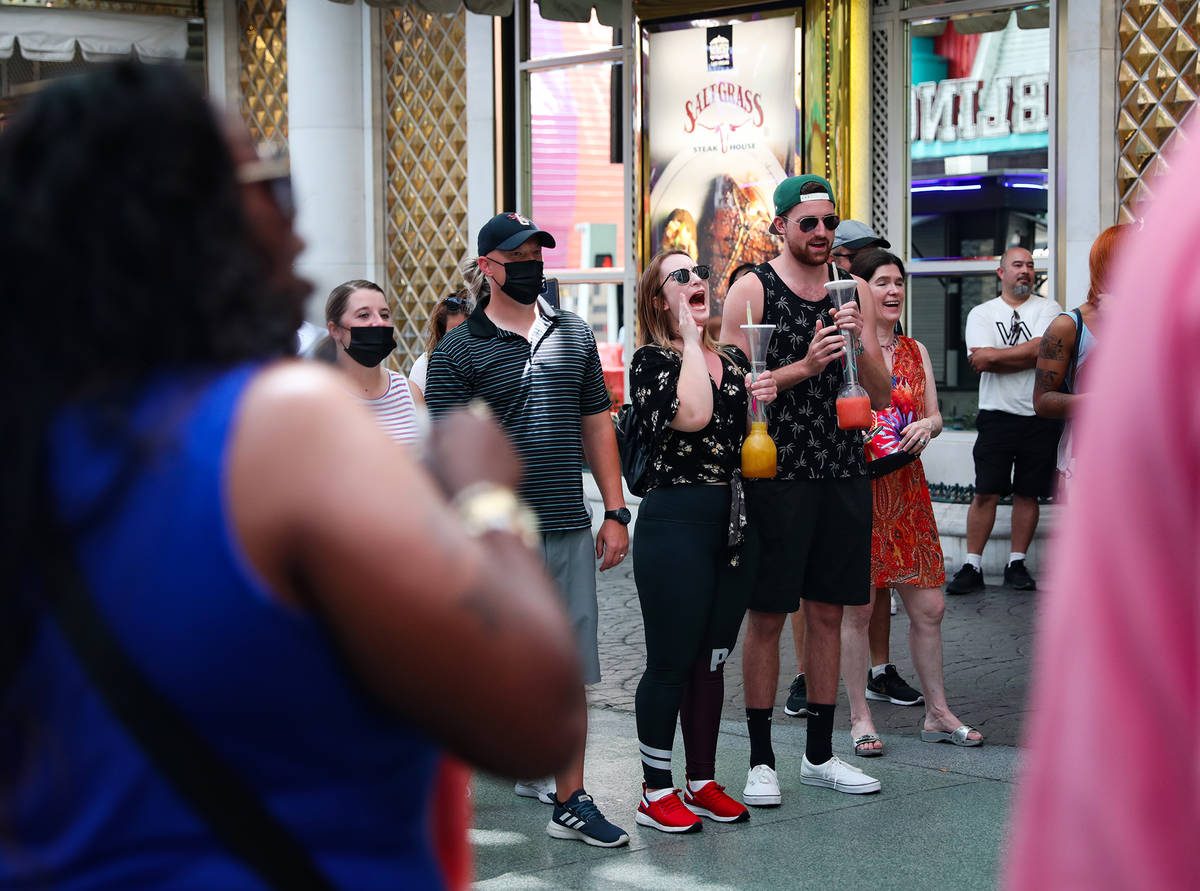 Spectators enjoy a show from buskers under the Fremont Street Experience in Downtown Las Vegas ...