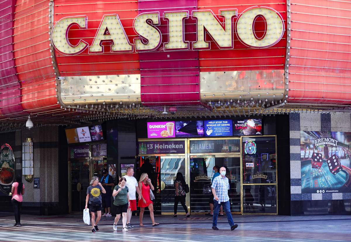 Visitors walk past the Fremont Casino at the Fremont Street Experience in Downtown Las Vegas We ...