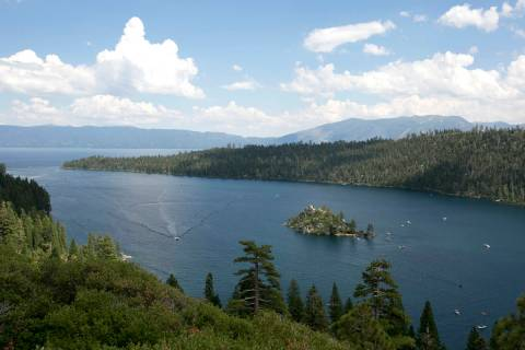 Boats ply the waters of Emerald Bay, near South Lake Tahoe, Calif., in 2017. (AP Photo/Rich Ped ...