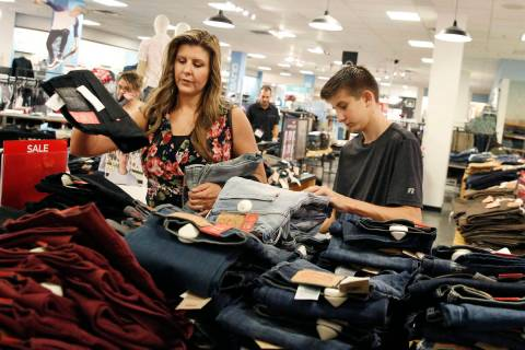 Levi Cartwright, 13, does his back to school shopping with his mother Christine at JCPenny on T ...