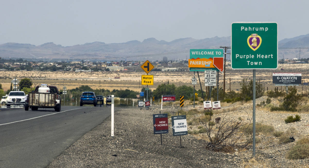 Traffic moves along at the city line for Pahrump, television station KPVM there is the setting ...