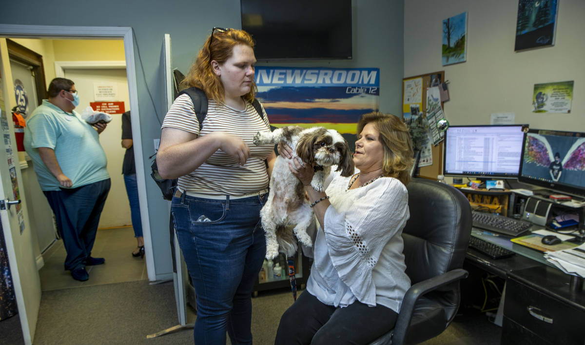 KPVM 25 News Director/Anchor Deanna O'Donnell, right, passes her dog Tommy off to daughter Darb ...