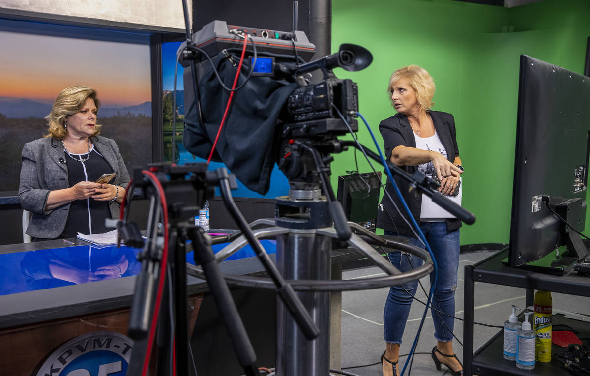 KPVM 25 news director/anchor Deanna O'Donnell, left, confers with Owner/Vice President Ronda Va ...