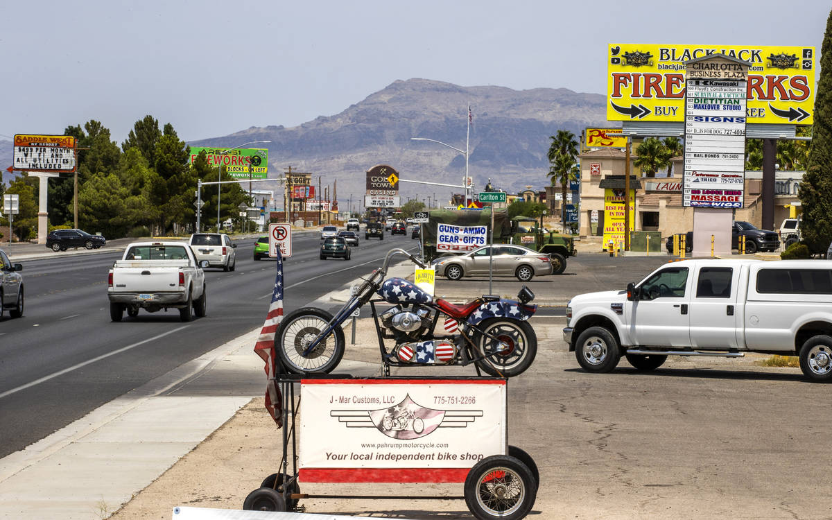 Traffic moves along State Route 16 in Pahrump, television station KPVM there is the setting for ...