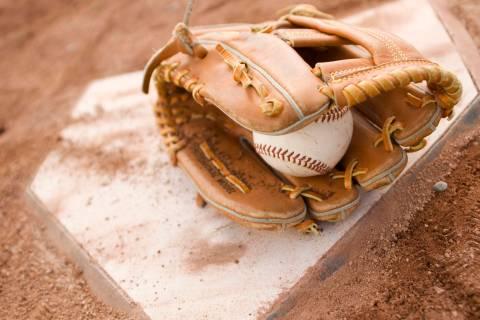 Baseball Glove on Diamond Plate. (Getty Images)