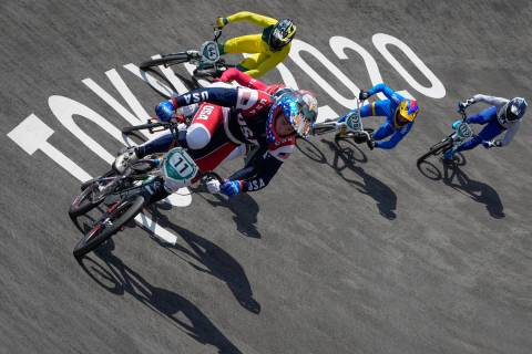 Connor Fields of the United States, center, leads with Anthony Dean of Australia, above, Carlos ...