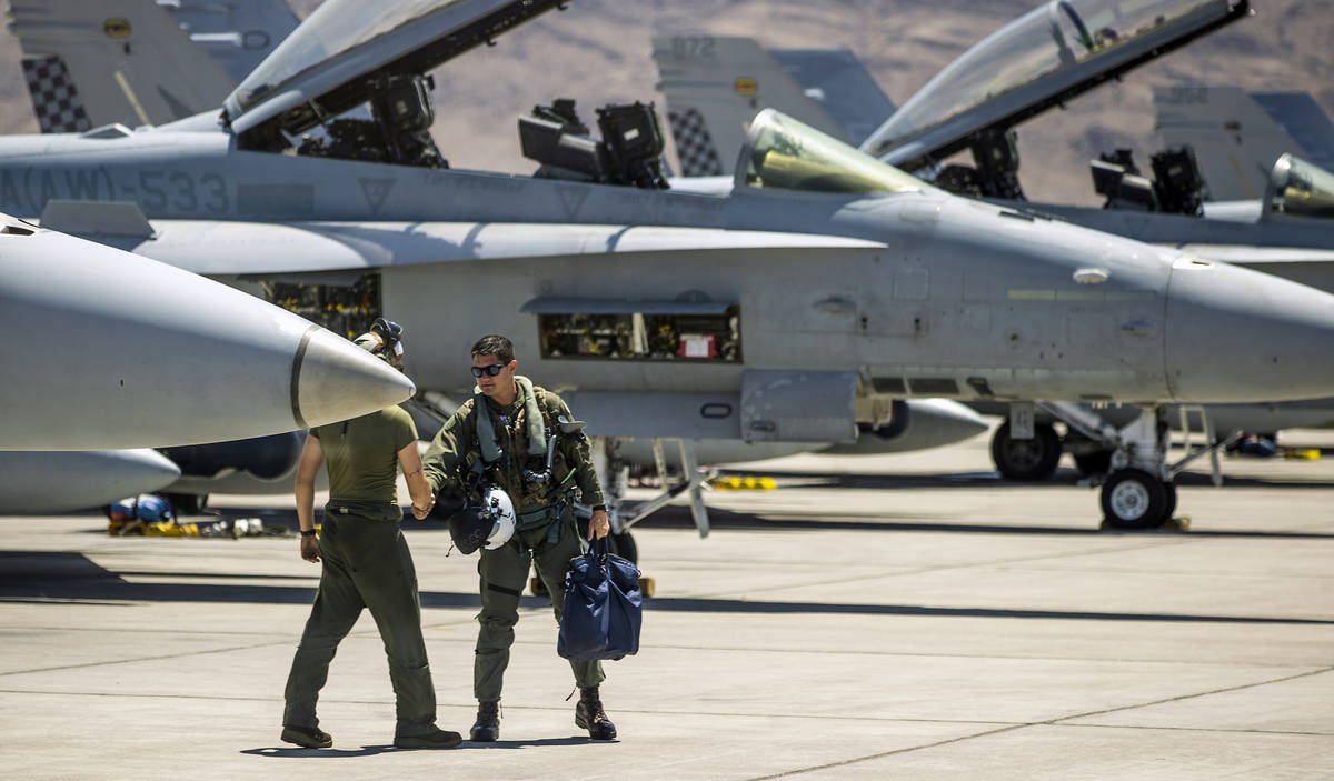 A pilots greets a crewman as he arrives at his jet on the flight line as Nellis Air Force Base ...