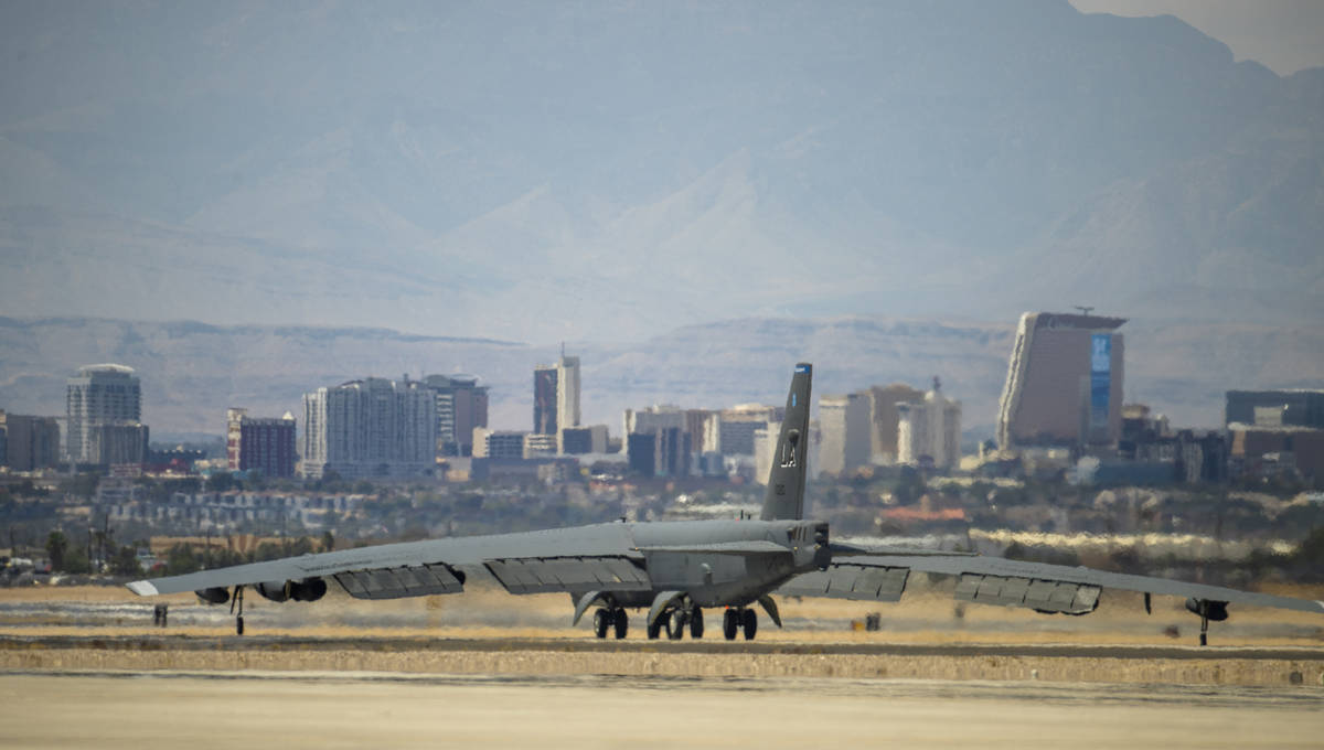 A B-52 Bomber rolls down the runway before takeoff as Nellis Air Force Base is hosting a RED FL ...