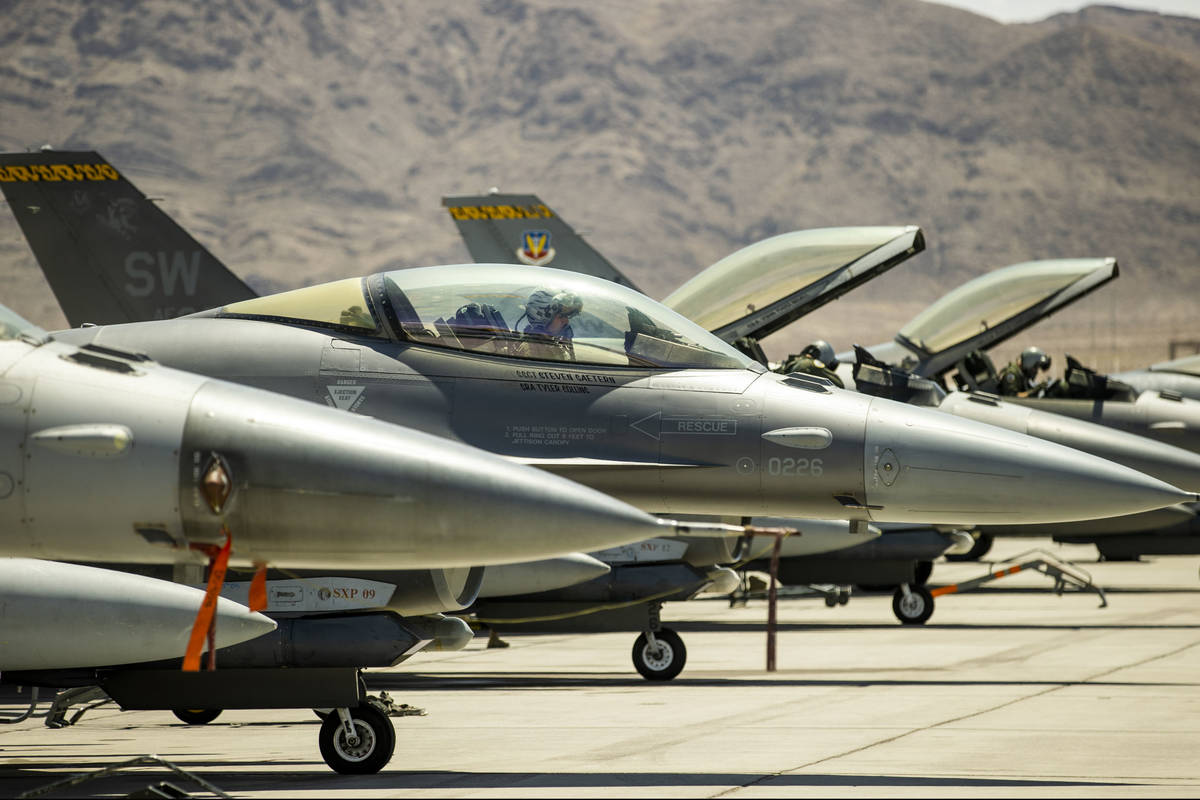 A pilot sits ready in the cockpit of an F-16 fighter jet as Nellis Air Force Base is hosting a ...