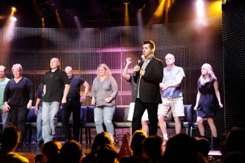 In this Nov. 21, 2013, file photo, comic hypnotist Marc Savard, center, mocks volunteer guests ...