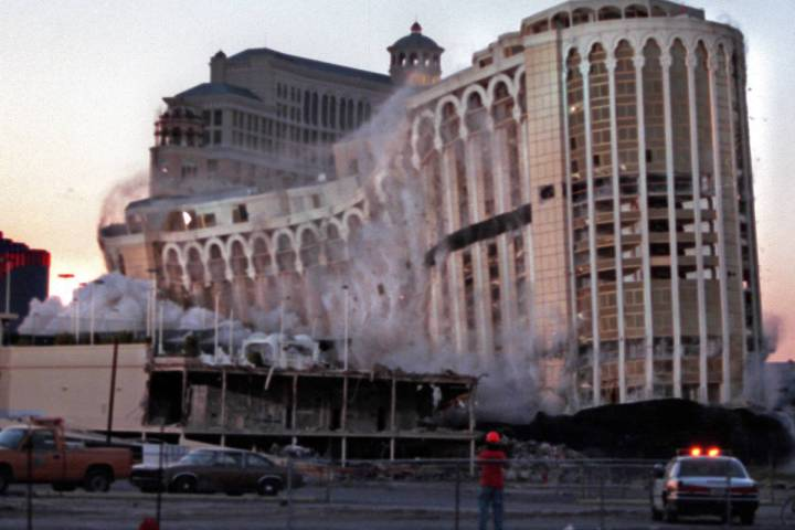 The Aladdin hotel-casino collapses under its own weight as it is imploded on the Las Vegas Stri ...