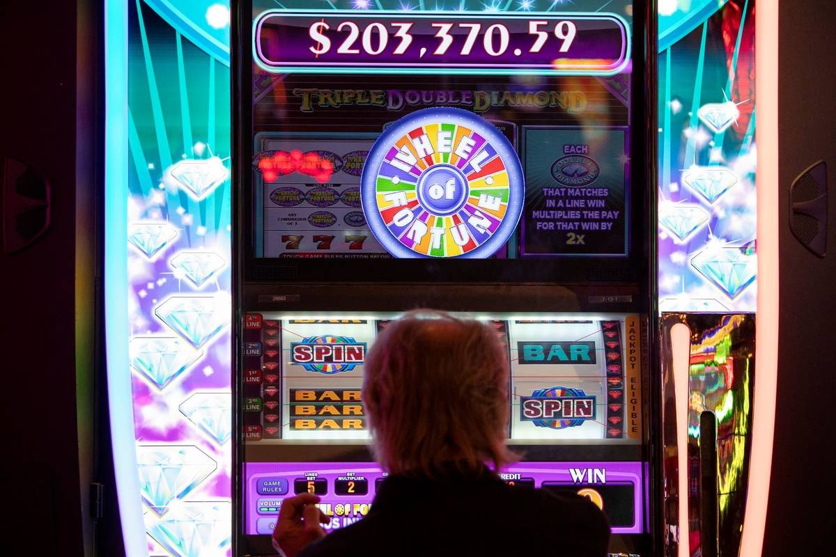 A gambler plays in the Wheel of Fortune slots zone at the Plaza Hotel and Casino on Friday, Jul ...