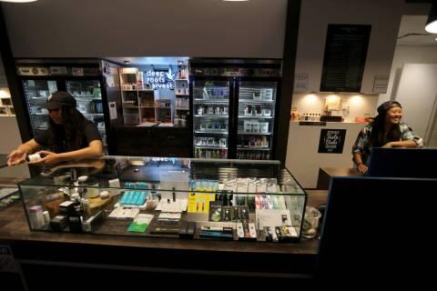 Alyssa Jusino, left, and Jezrey Saenz help customers at Exhale Nevada marijuana dispensary in L ...