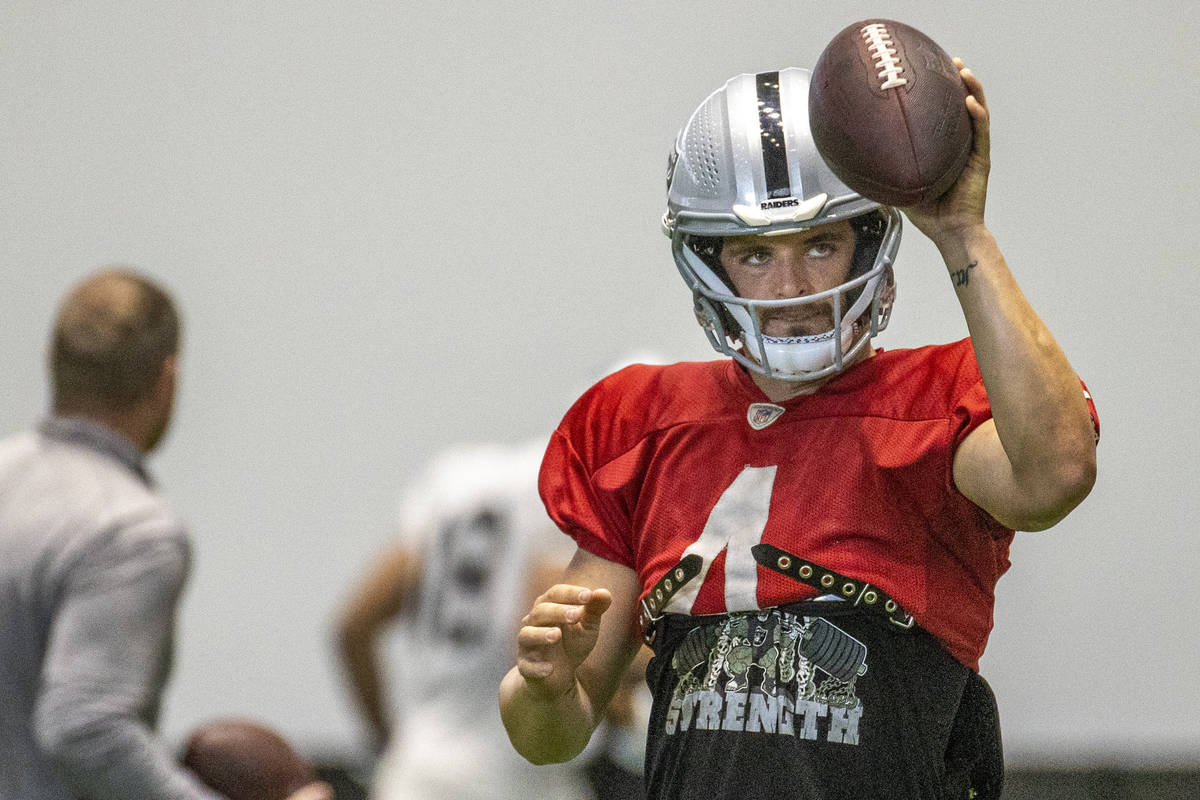 Raiders quarterback Derek Carr (4) signals to a receiver during practice at the Intermountain H ...
