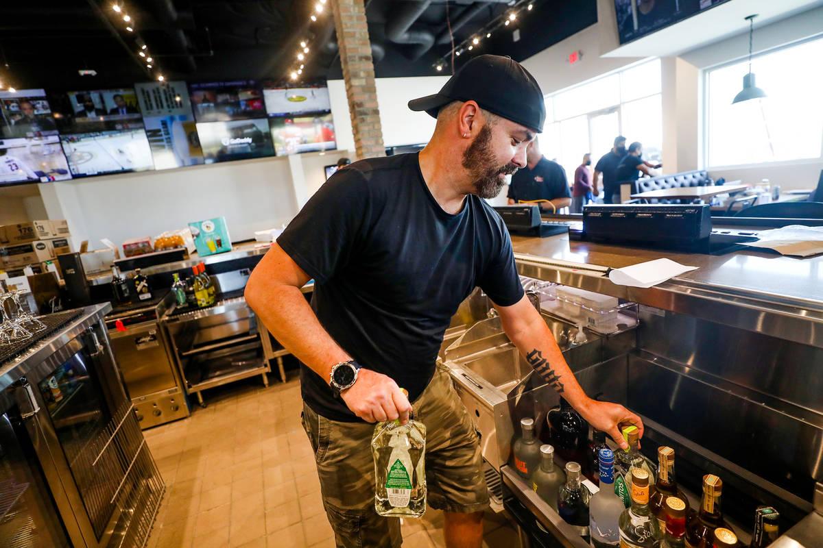 Bartender Mark Killgren organizes alcohol at the new PKWY Tavern in Henderson, Thursday, Aug. 5 ...