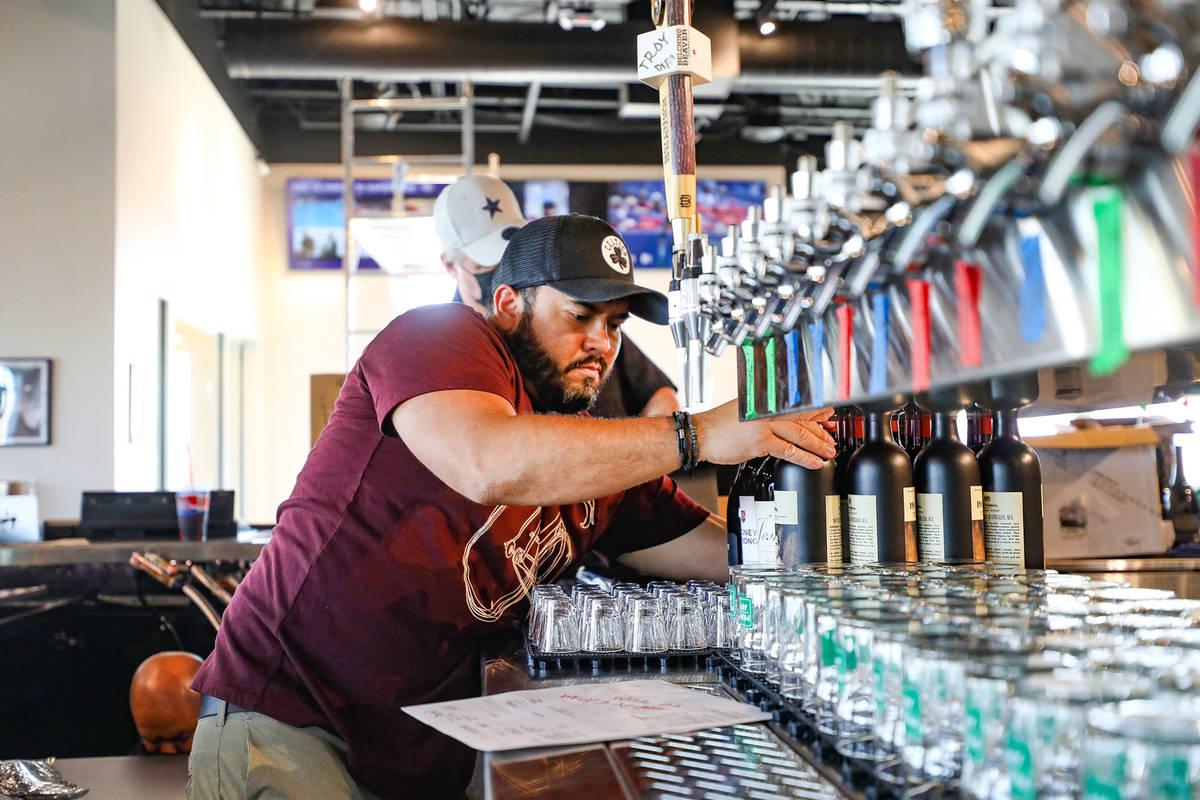 Bartender Edward Parker organizes wine bottles at the new PKWY Tavern in Henderson, Thursday, A ...
