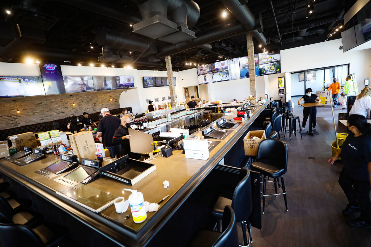 Employees work on the finishing touches of the new PKWY Tavern in Henderson, near St. Rose Park ...