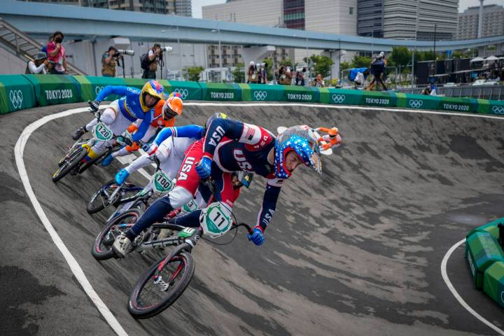 Connor Fields of the United States, center, who later crashed, is followed by Romain Mahieu of ...