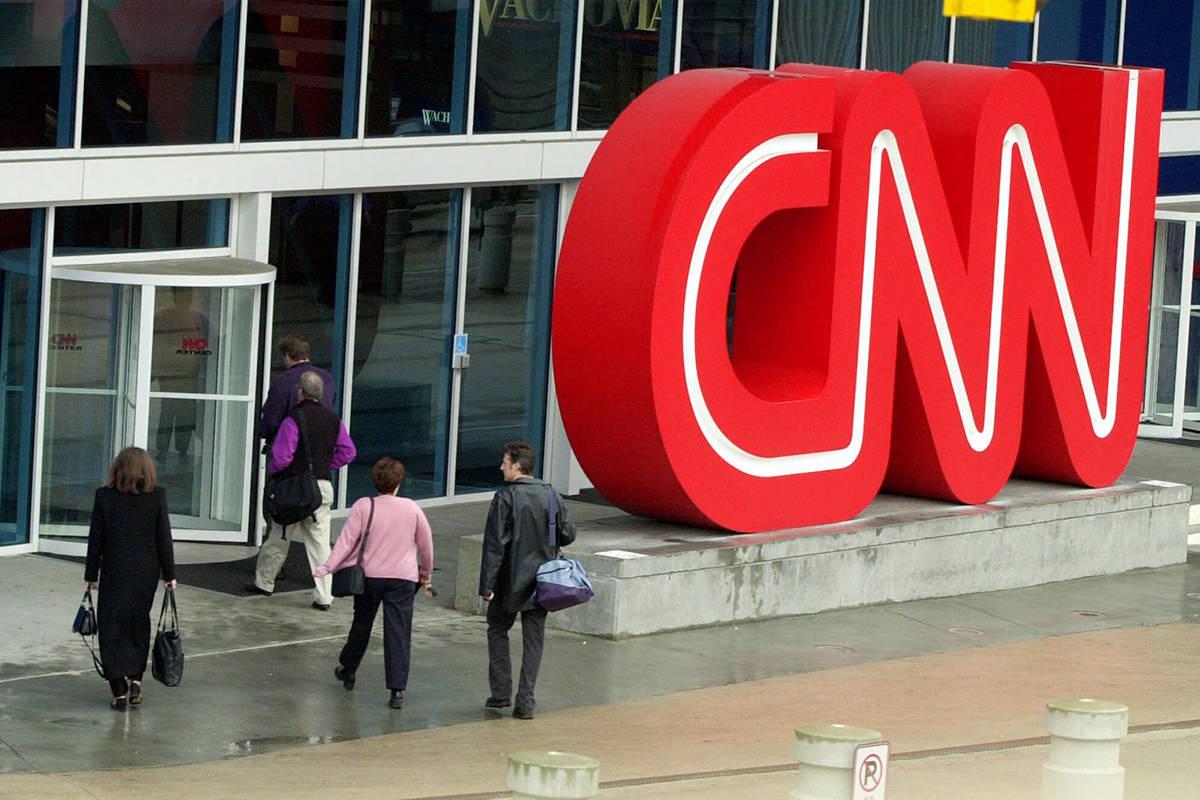 This Jan. 17, 2001 file photo shows pedestrians entering CNN Center, the headquarters for CNN, ...