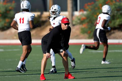 UNLV Rebels head coach Marcus Arroyo watches his players during football practice in UNLV, Wedn ...