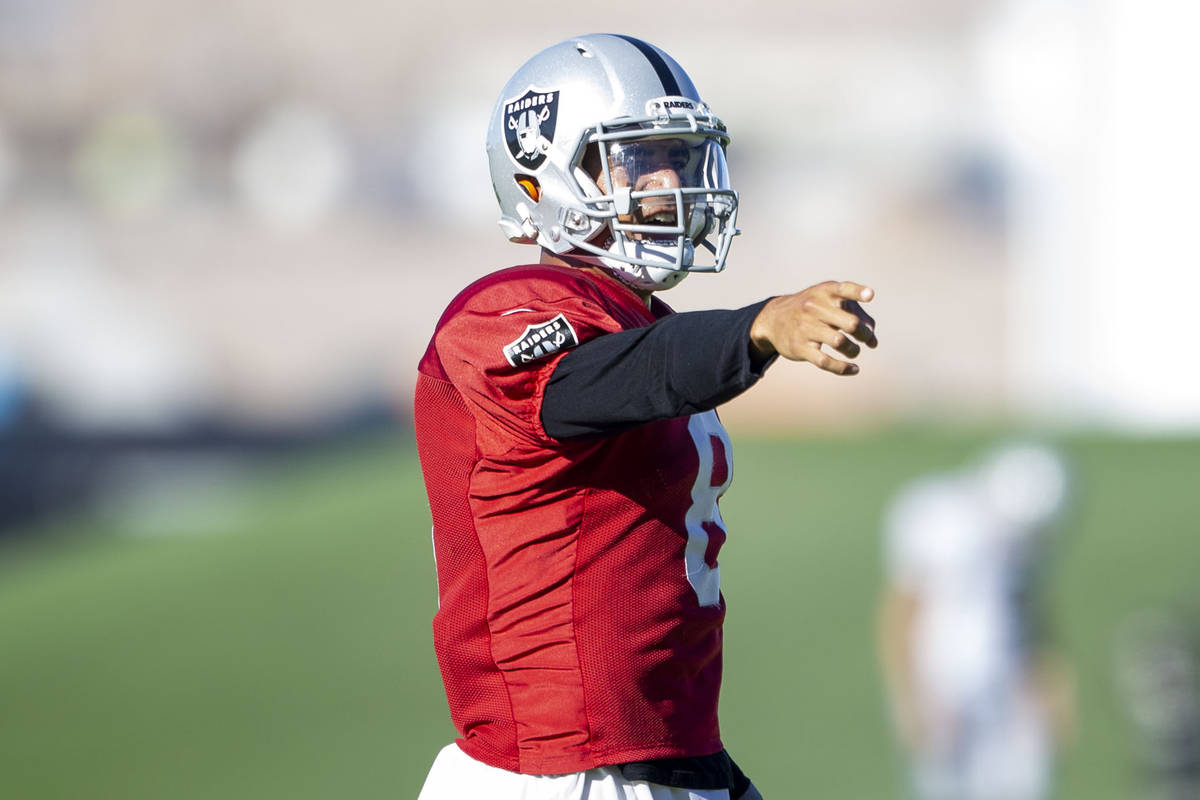 Raiders quarterback Marcus Mariota (8) reacts after throwing a pass during their NFL training c ...
